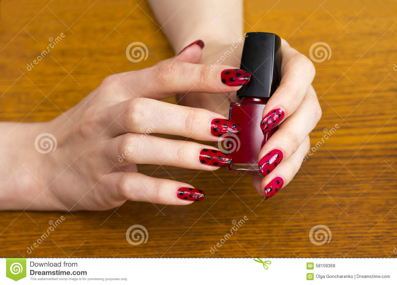 Download Hands Girls Holding A Bottle Of Red Nail Polish Stock Photo