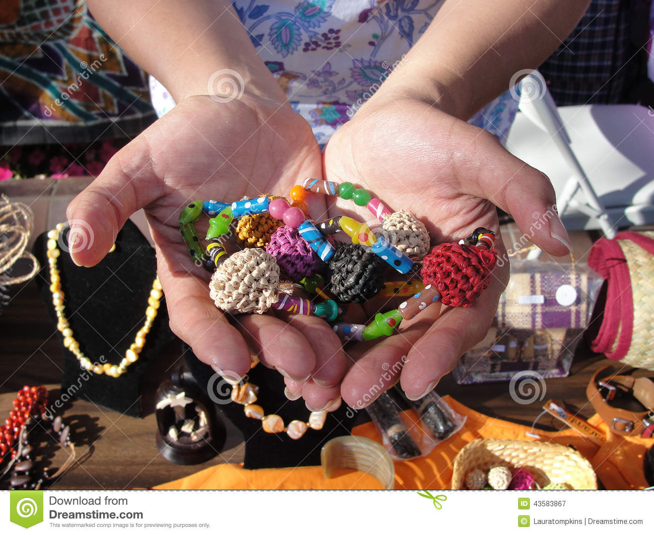 Hands with a Variety of Beads