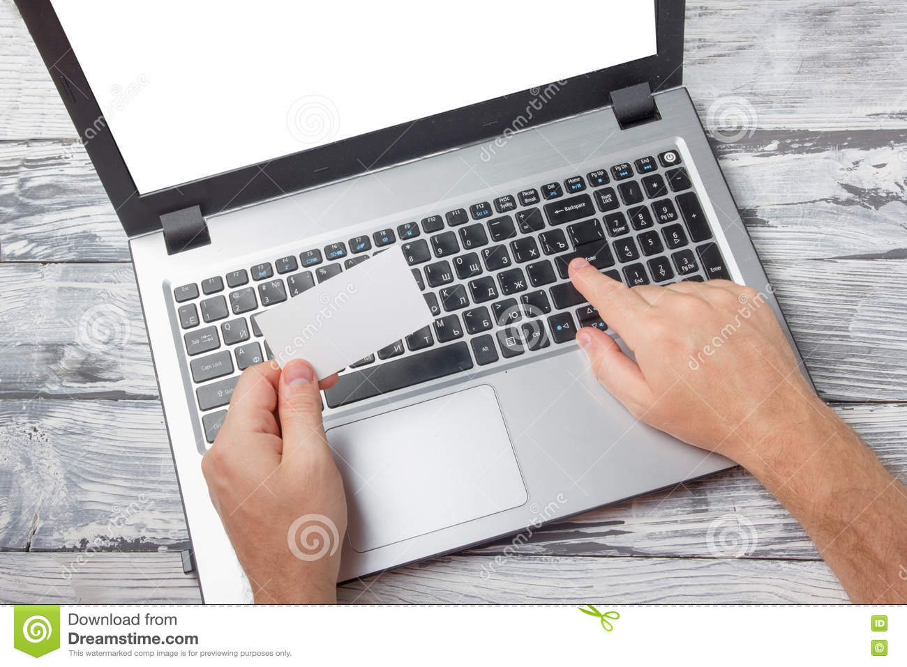 Hands holding business credit card typing numbers laptop computer download hands holding business credit card typing numbers laptop computer pc keyboard making online payment download comp reheart Images
