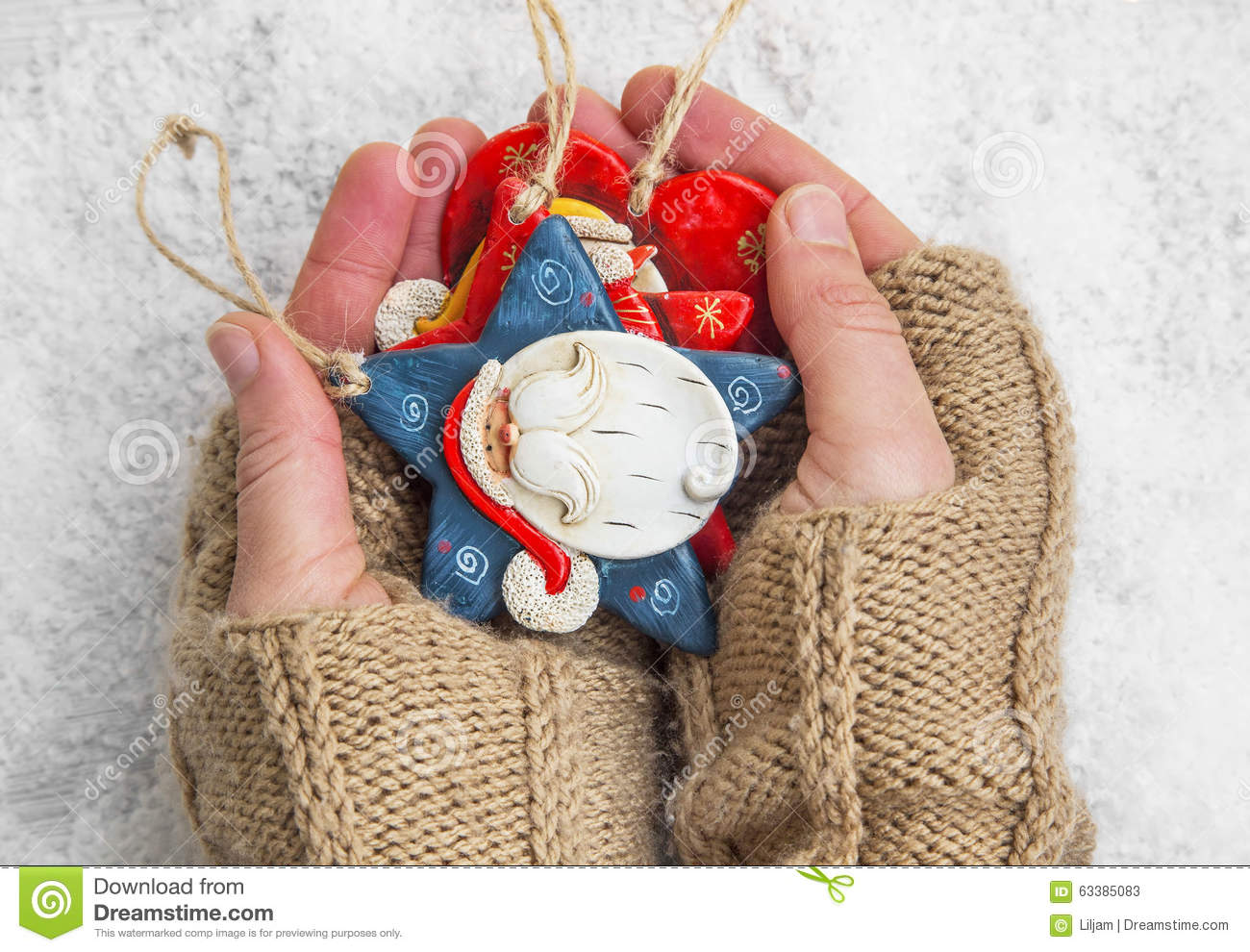 Hands Holding Christmas Ornaments Stock Photo