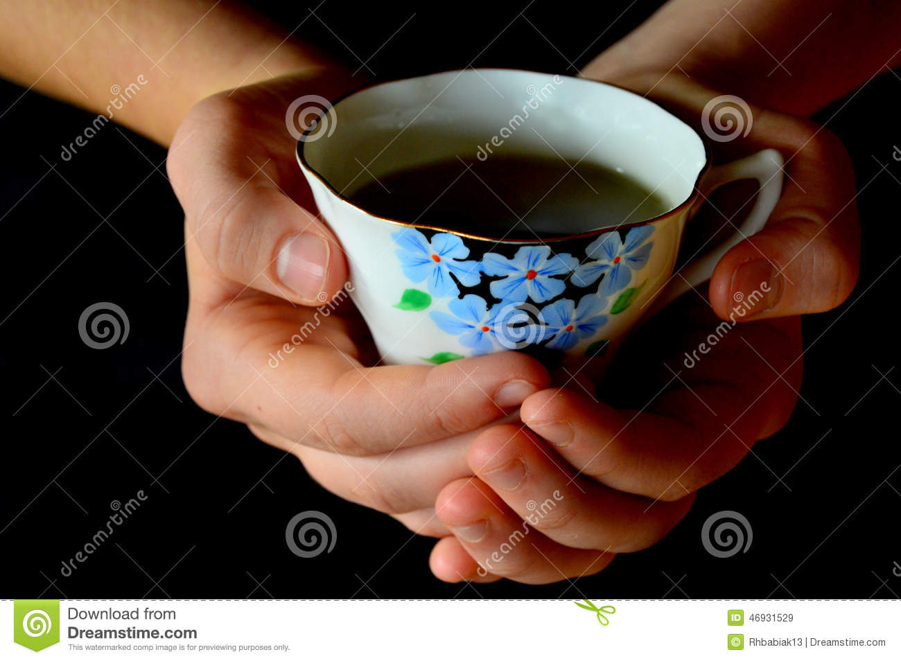 Hands Holding Cup of Tea