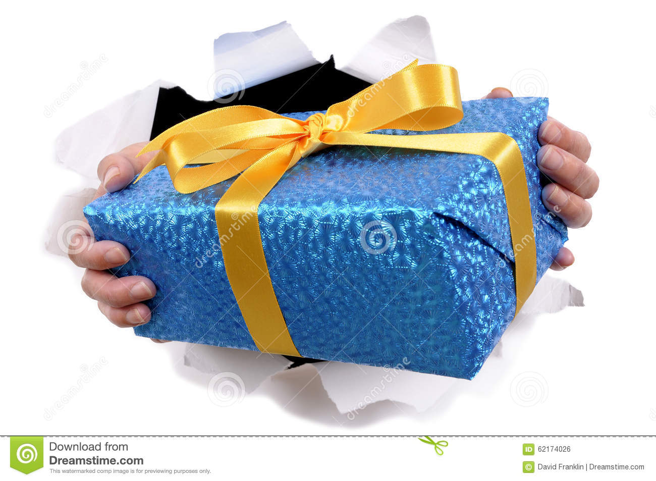 Hands Holding Delivering Or Giving Small Christmas Or Birthday Gift
