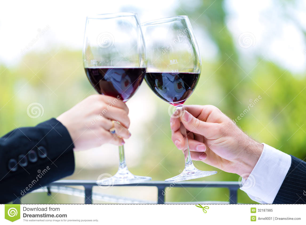 Hands Holding Red Wine Glasses To Clink Royalty Free Stock Photo