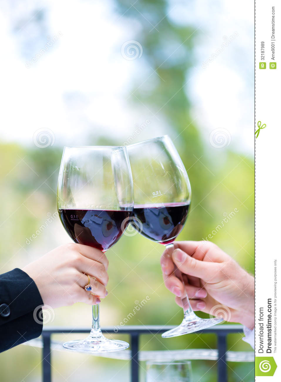Hands Holding Red Wine Glasses To Clink Royalty Free Stock Images