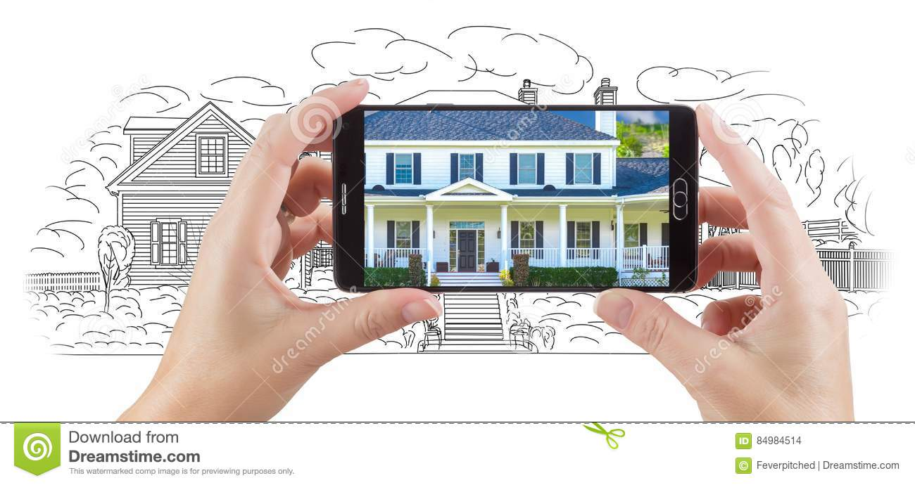 Hands Holding Smart Phone Displaying Home Photo of Drawing Behind