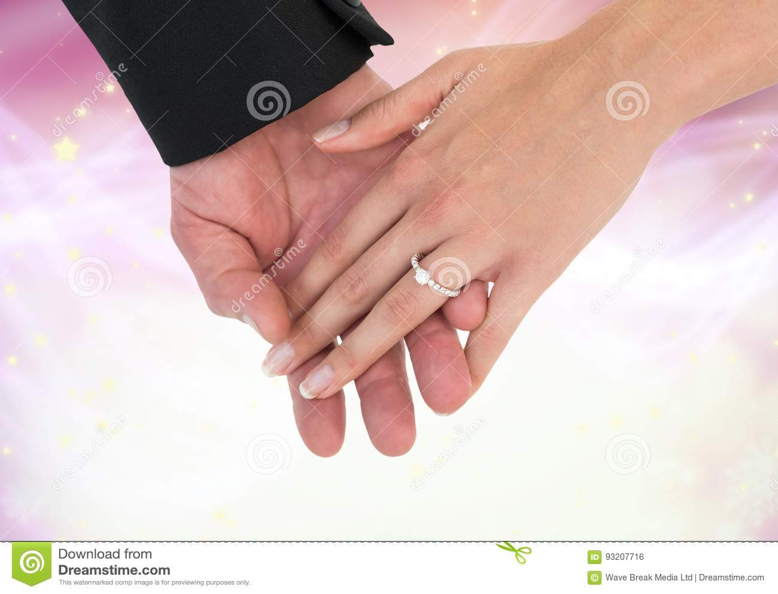 Hands Holding Together Wedding Engagement Ring With Sparkling Light ...