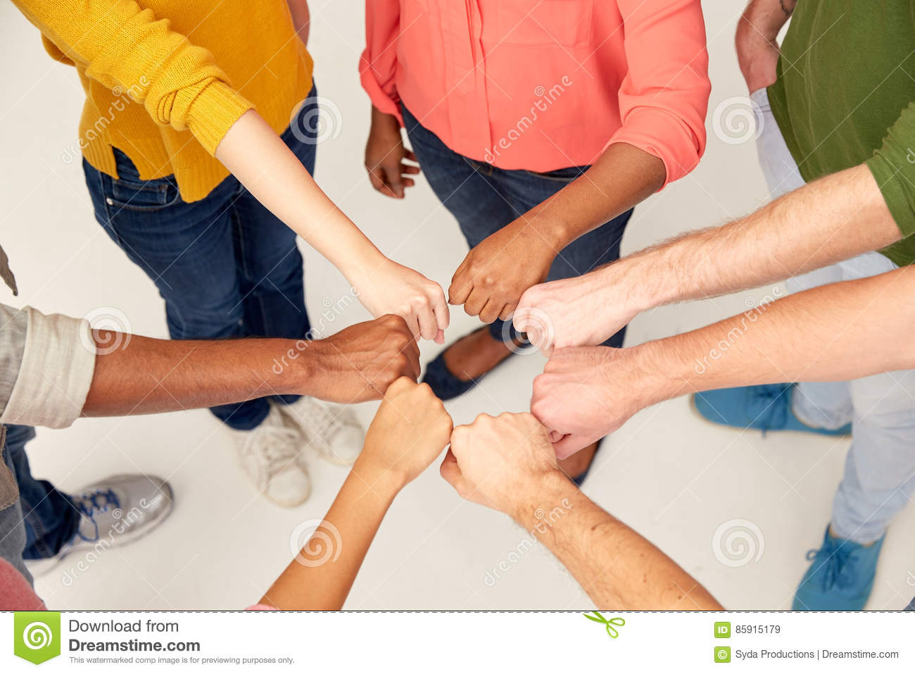 Fist bump stock photos royalty free images hands of international people making fist bump teamwork friendship international gesture and m4hsunfo