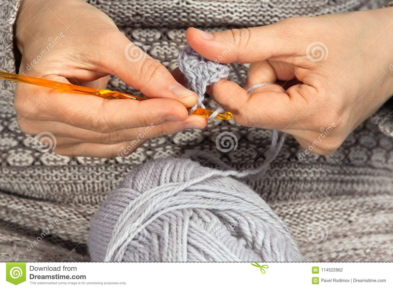 Hands Knitting With Crochet Hook And Grey Yarn Stock Photo Image