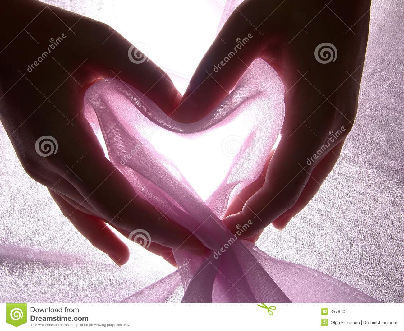 Hands make heart from cloth