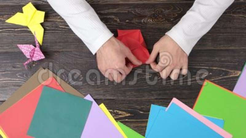 Hands making origami flower with red paper stock footage video of hands making origami flower with red paper stock footage video of hand fast 123019800 mightylinksfo