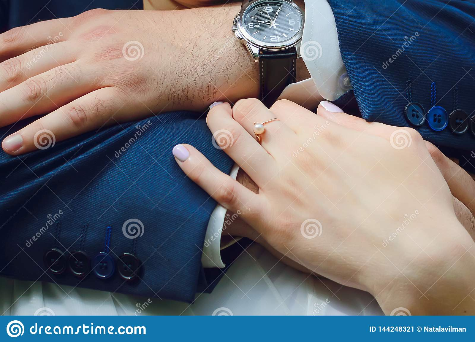 Hands of a man and a woman, close-up. Embrace, love, wedding
