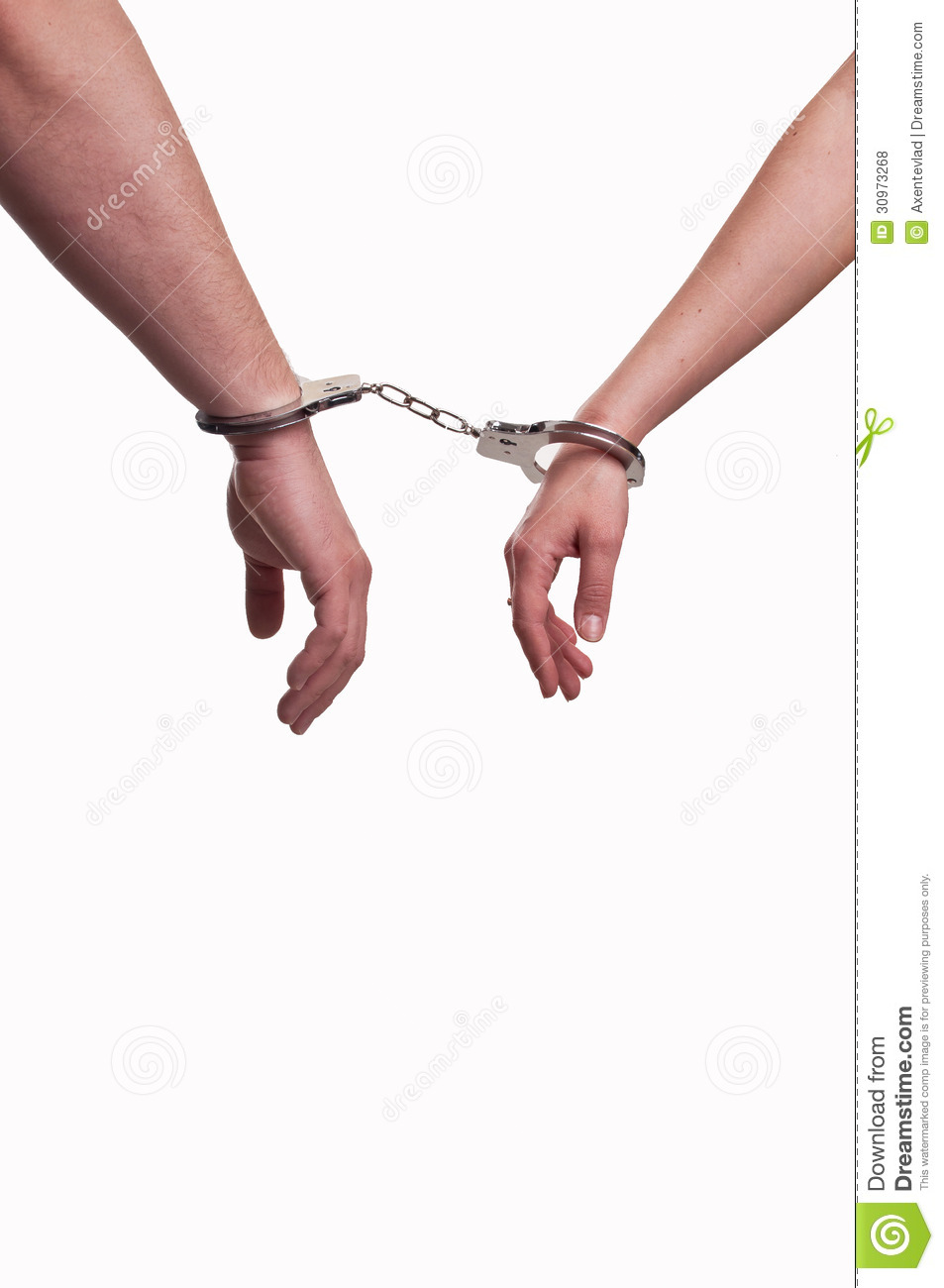 Hands of a man and a woman in handcuffs - relationship concept
