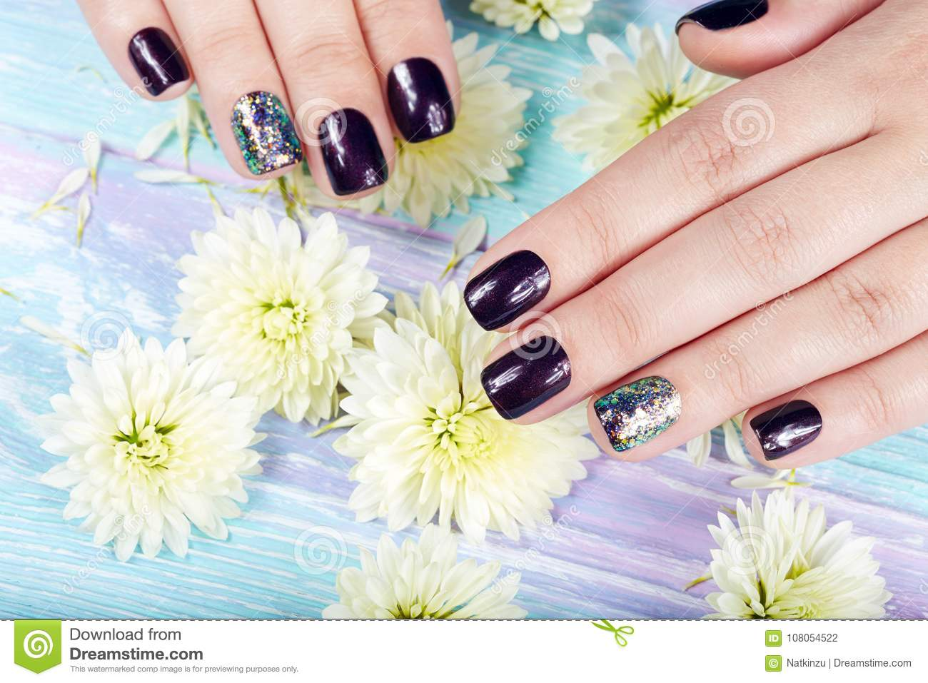 Hands With Manicured Nails Colored With Dark Purple Nail Polish ...