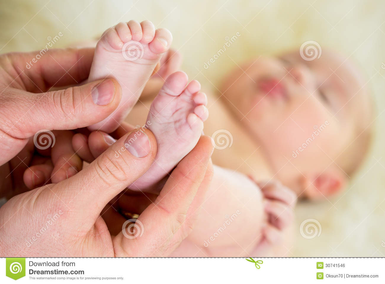 hands massaging small baby feet royalty free stock image image 30741546. Black Bedroom Furniture Sets. Home Design Ideas