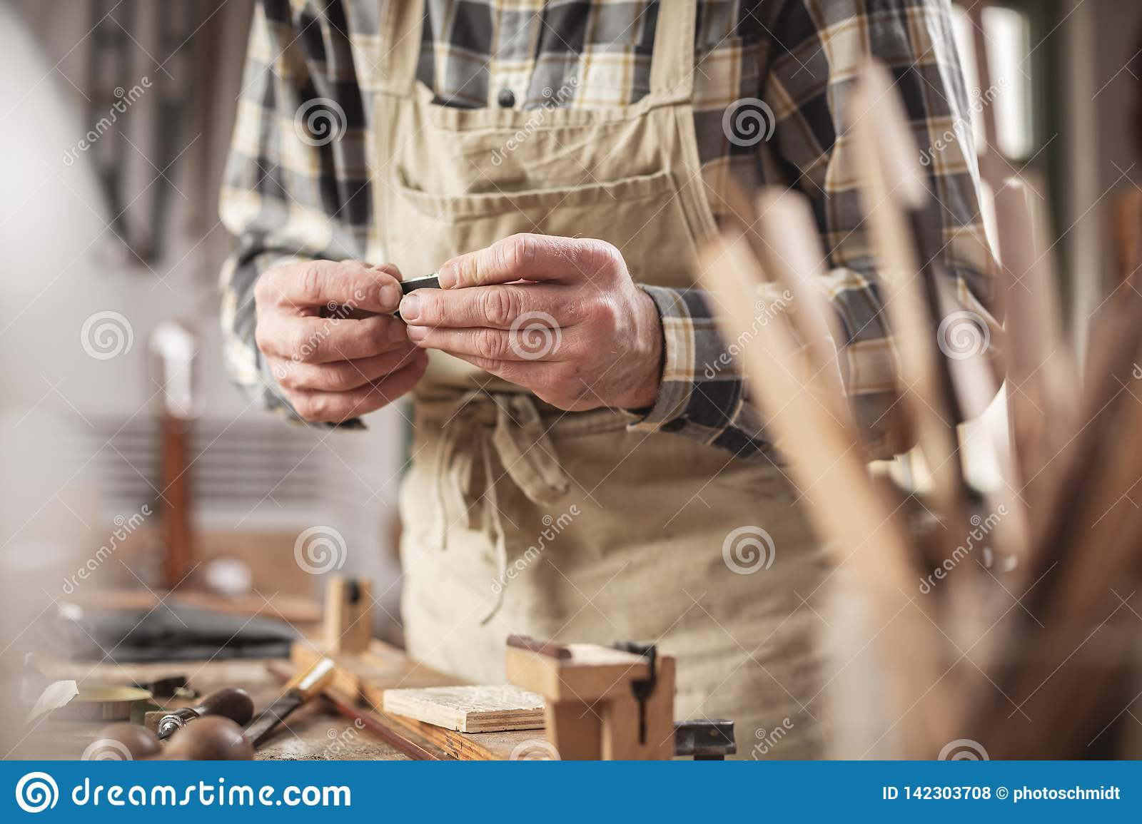 Hands of a mature carpenter