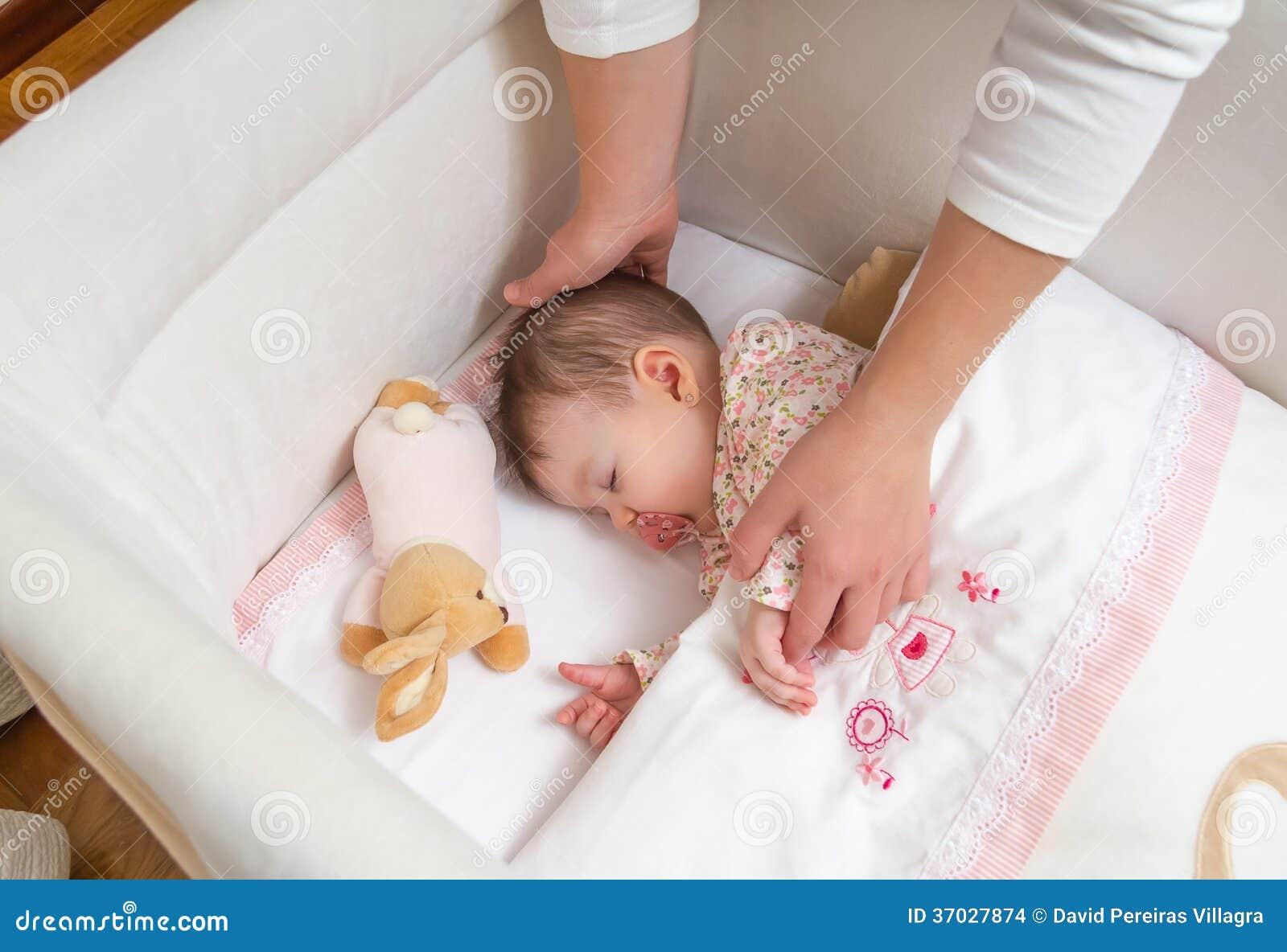 Hands Of Mother Caressing Her Baby Girl Sleeping Stock