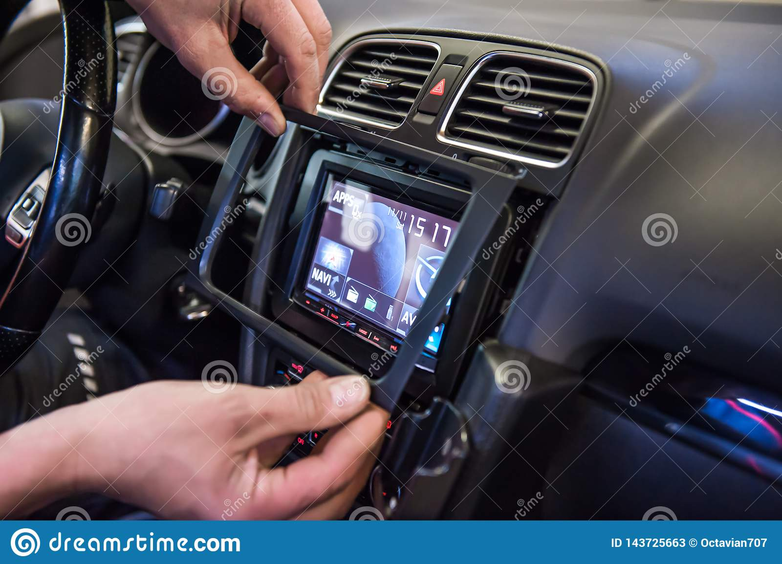 Hands mounting frame on touch display in car