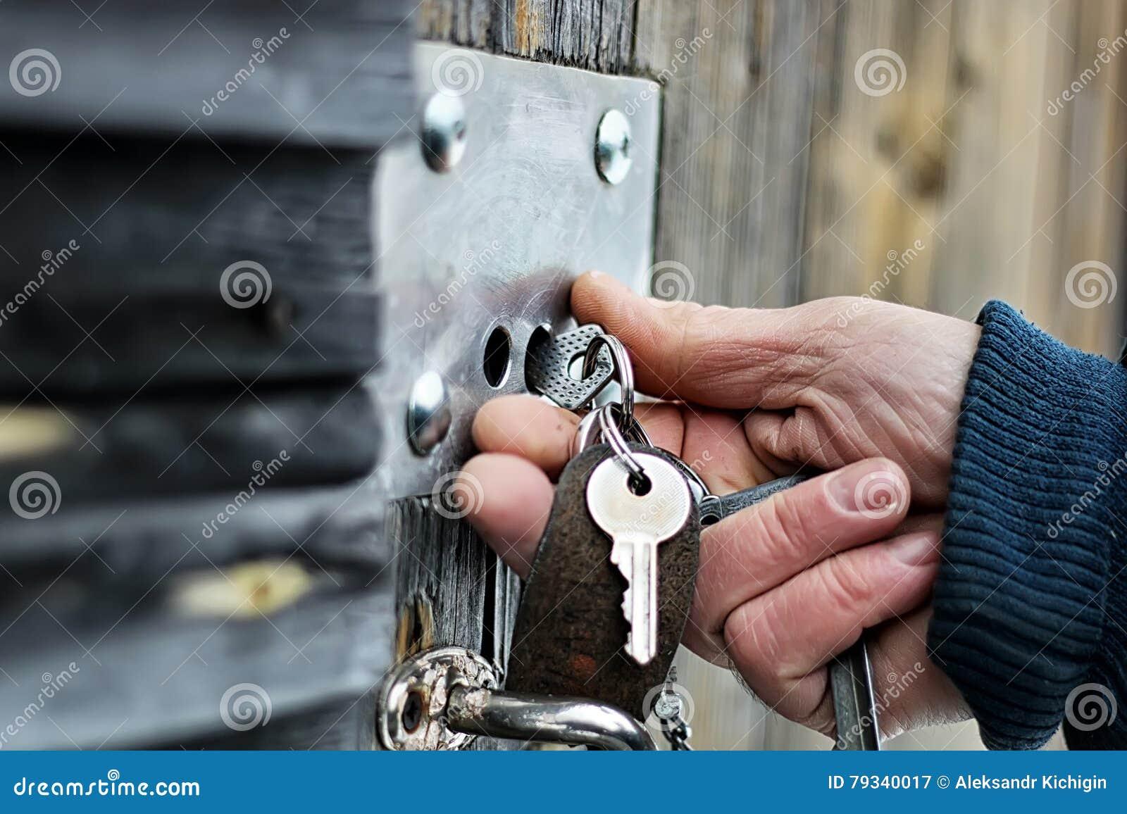 Hands open padlock