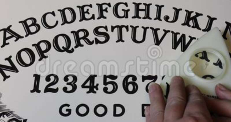 Hands On Ouija Board Spelling Hello Stock Footage Video Of Game