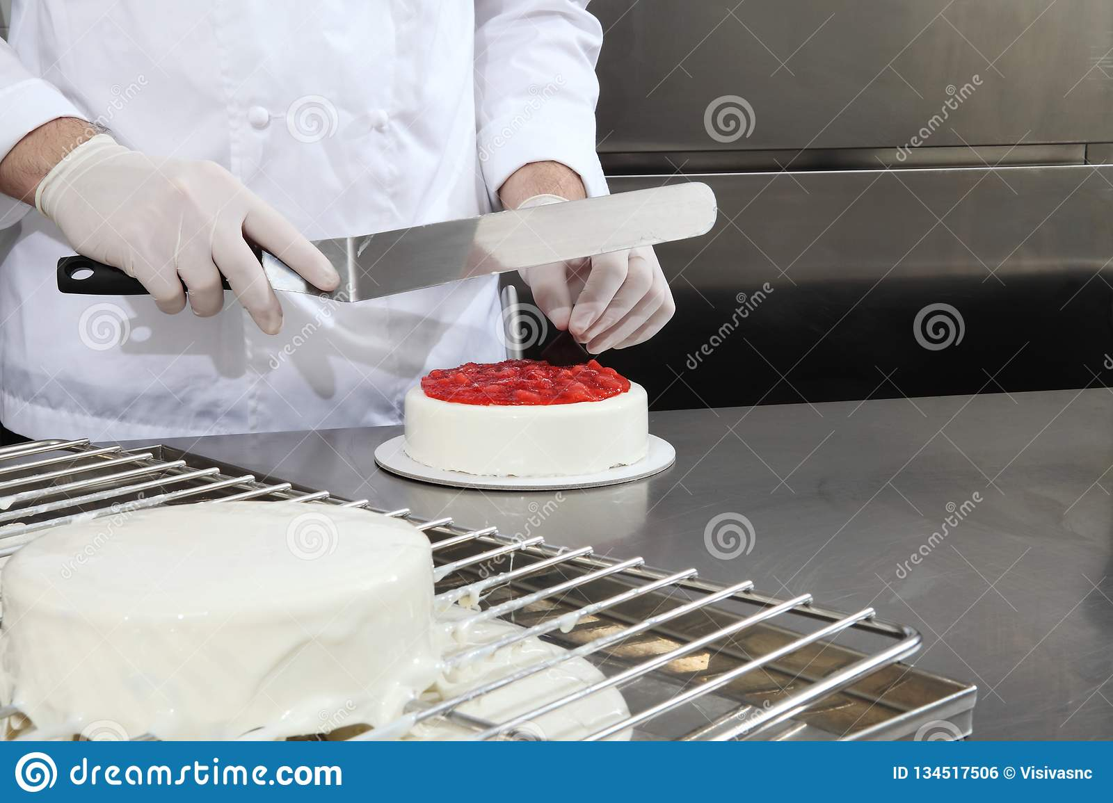 Hands Pastry Chef Prepares A Cake Cover With Icing And