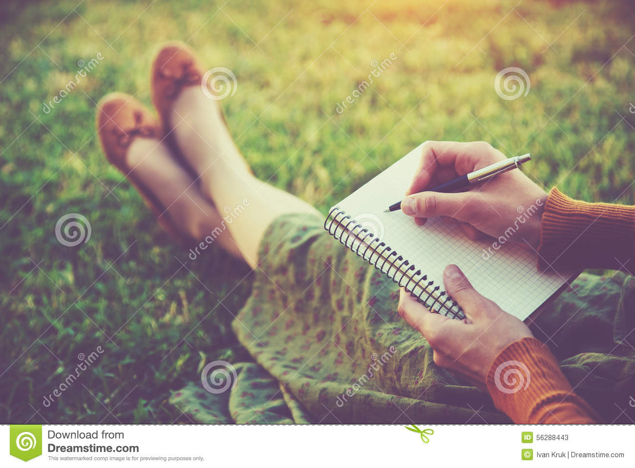 Hands with pen writing