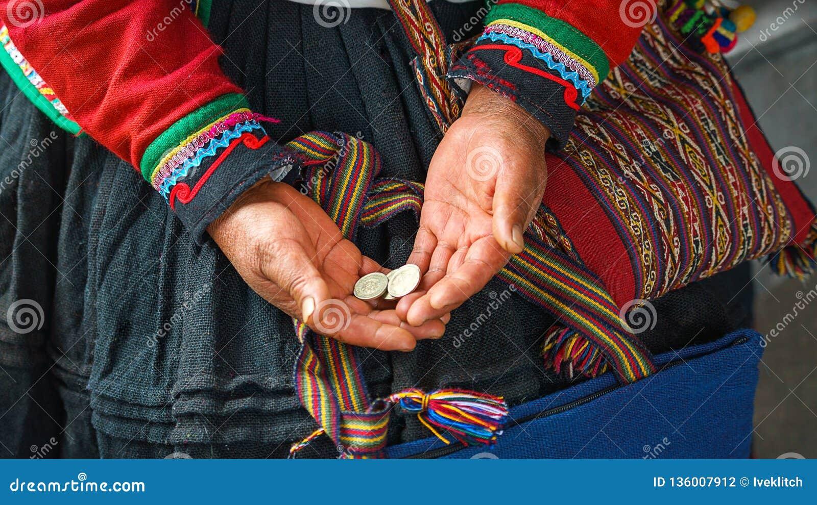 Close up of weaving and culture in Peru. Cusco, Peru: woman dressed in colorful traditional native Peruvian closing holding