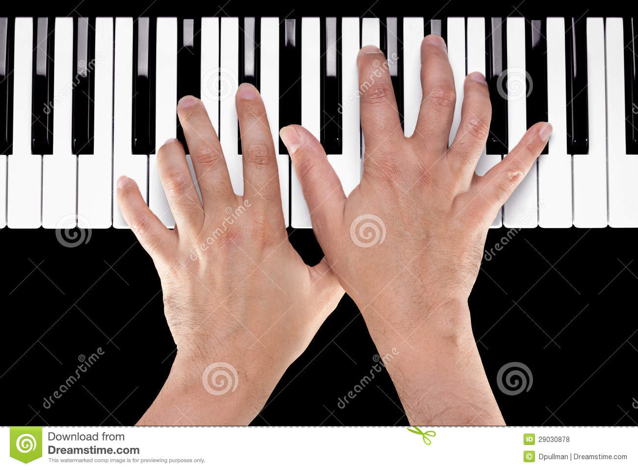 Hands On A Piano Keyboard Royalty Free Stock Photos