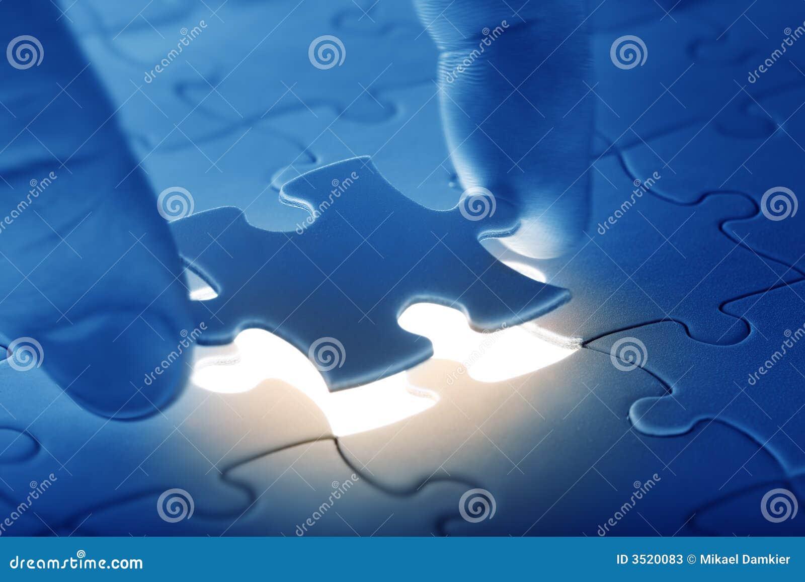 Hands placing last piece of a
