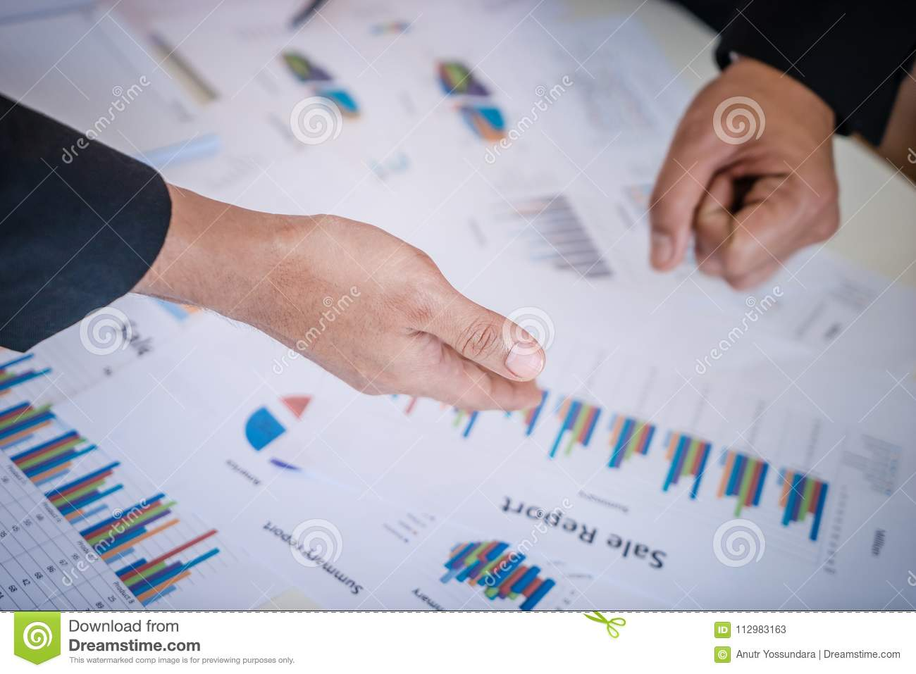 Hands pointing on data chart for business meeting