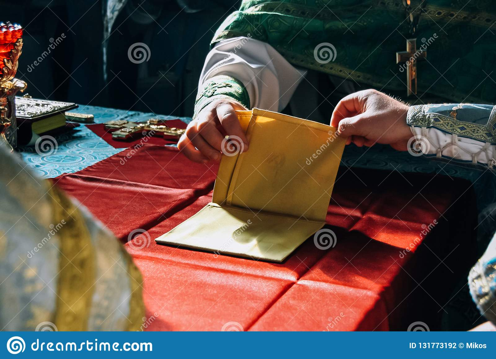 The hands of the priests and blessed altar cloth in the altar of the church
