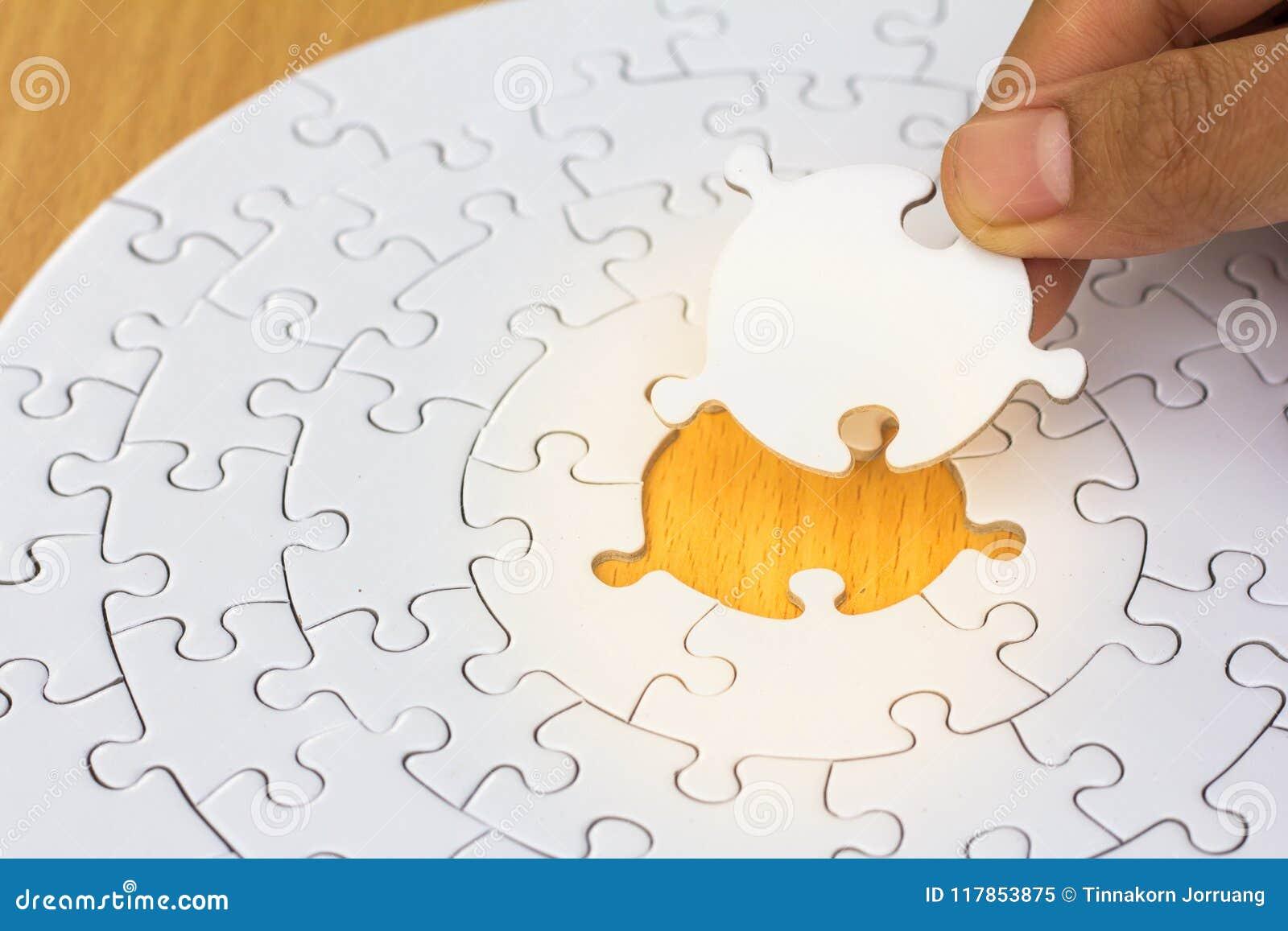 Hands Put The Final Piece Of Jigsaw Successful Business Ideas Stock