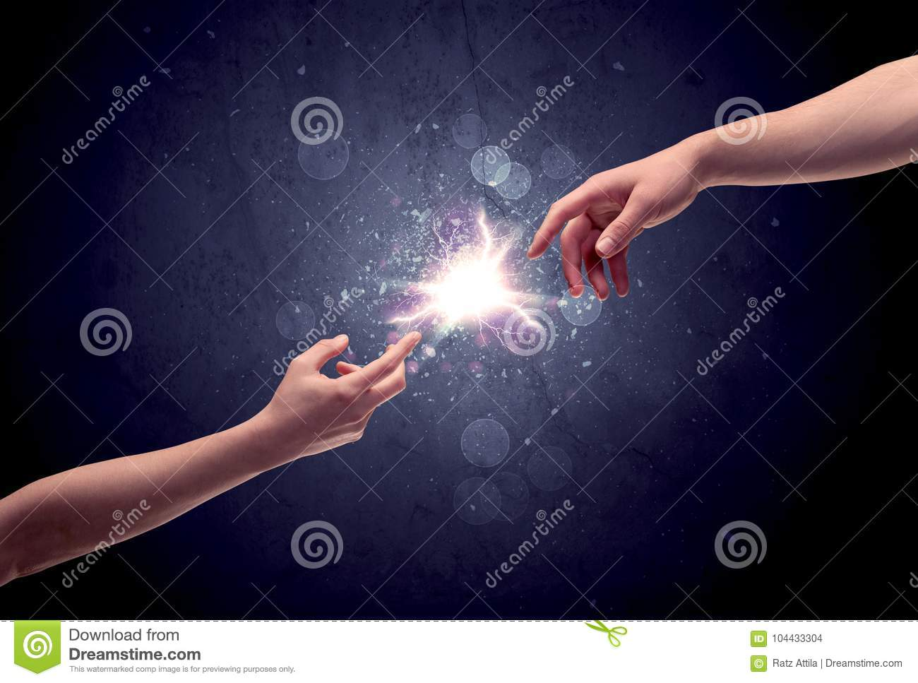 Hands reaching to light a spark