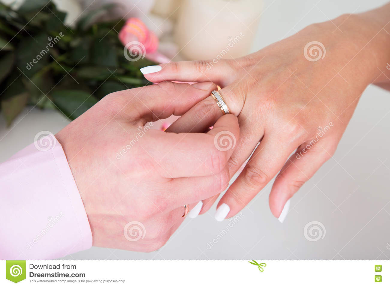 Hands With Rings Groom Putting Golden Ring On Bride\'s Finger Dur ...