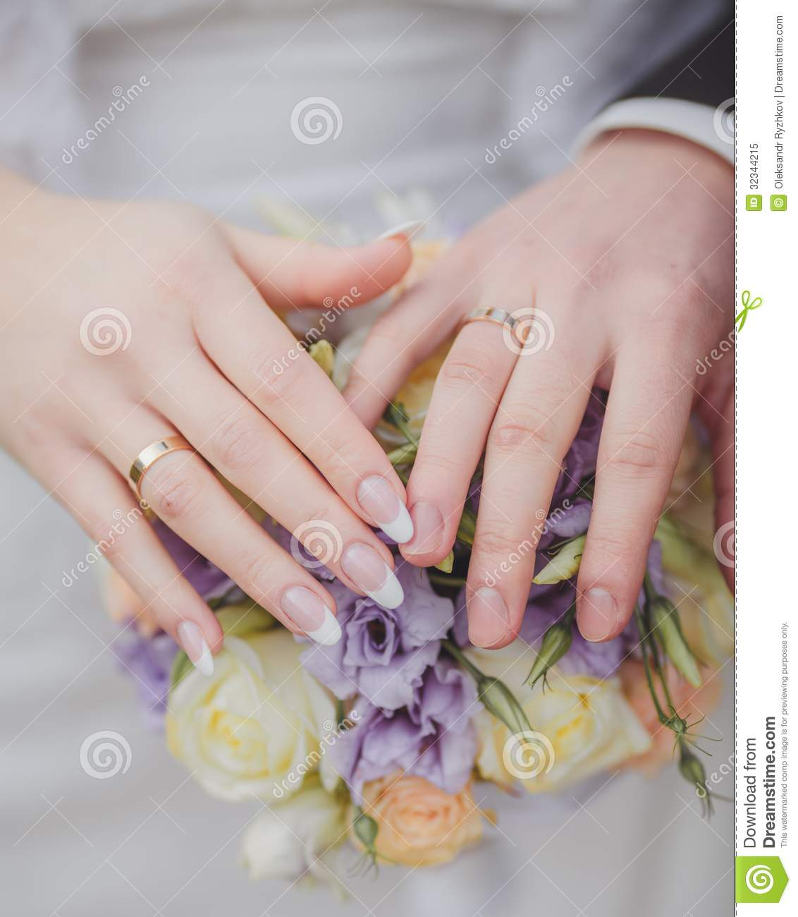Hands And Rings On The Wedding Bouquet Stock Image - Image of ...