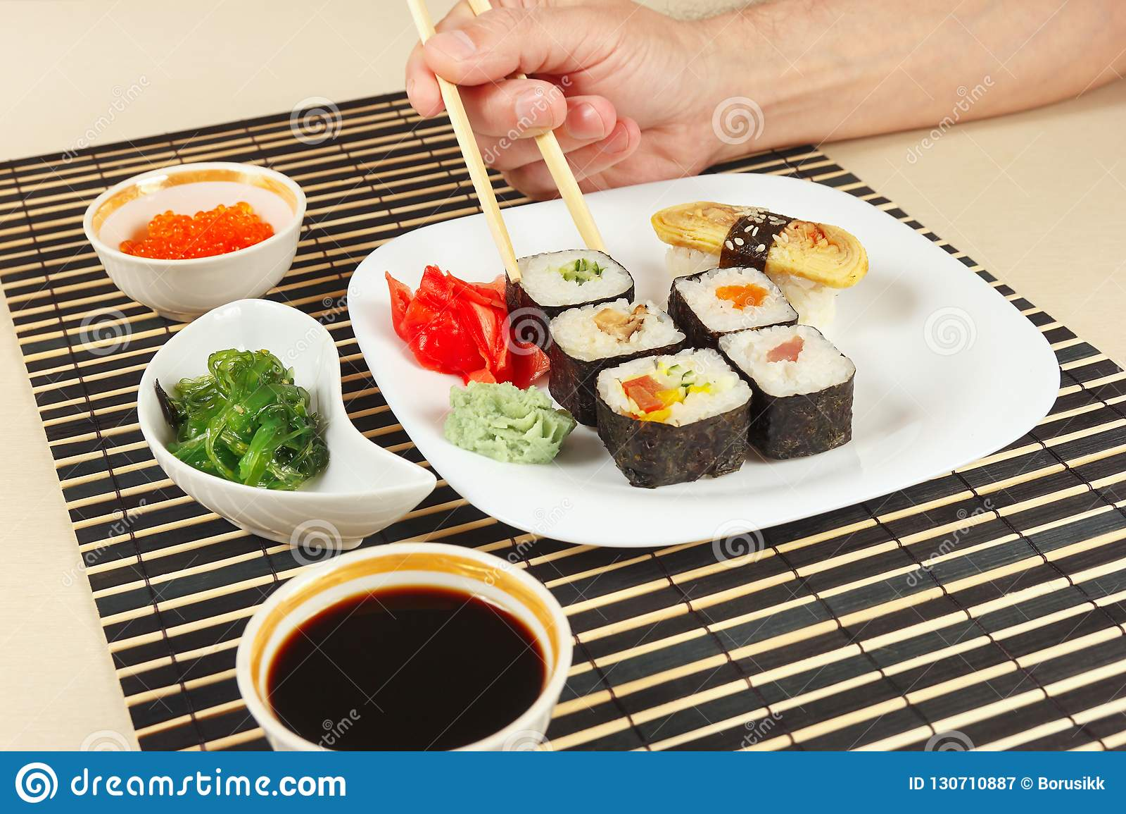 Hands Taking Sushi With Chopsticks Assorted Sushi Chuka