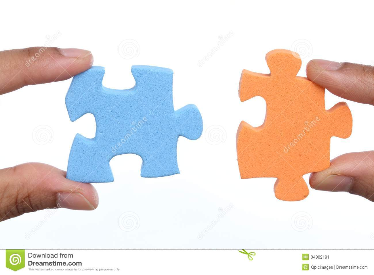 Hands To Attach Two Jigsaw Puzzle Pieces