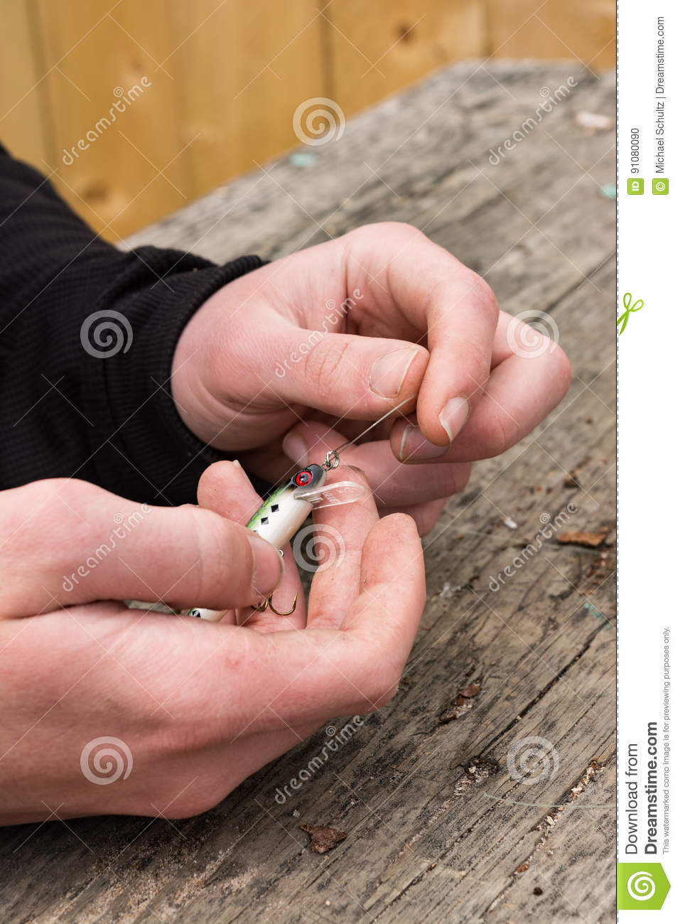 Hands tying fishing lure stock photo. Image of fishing - 91080090