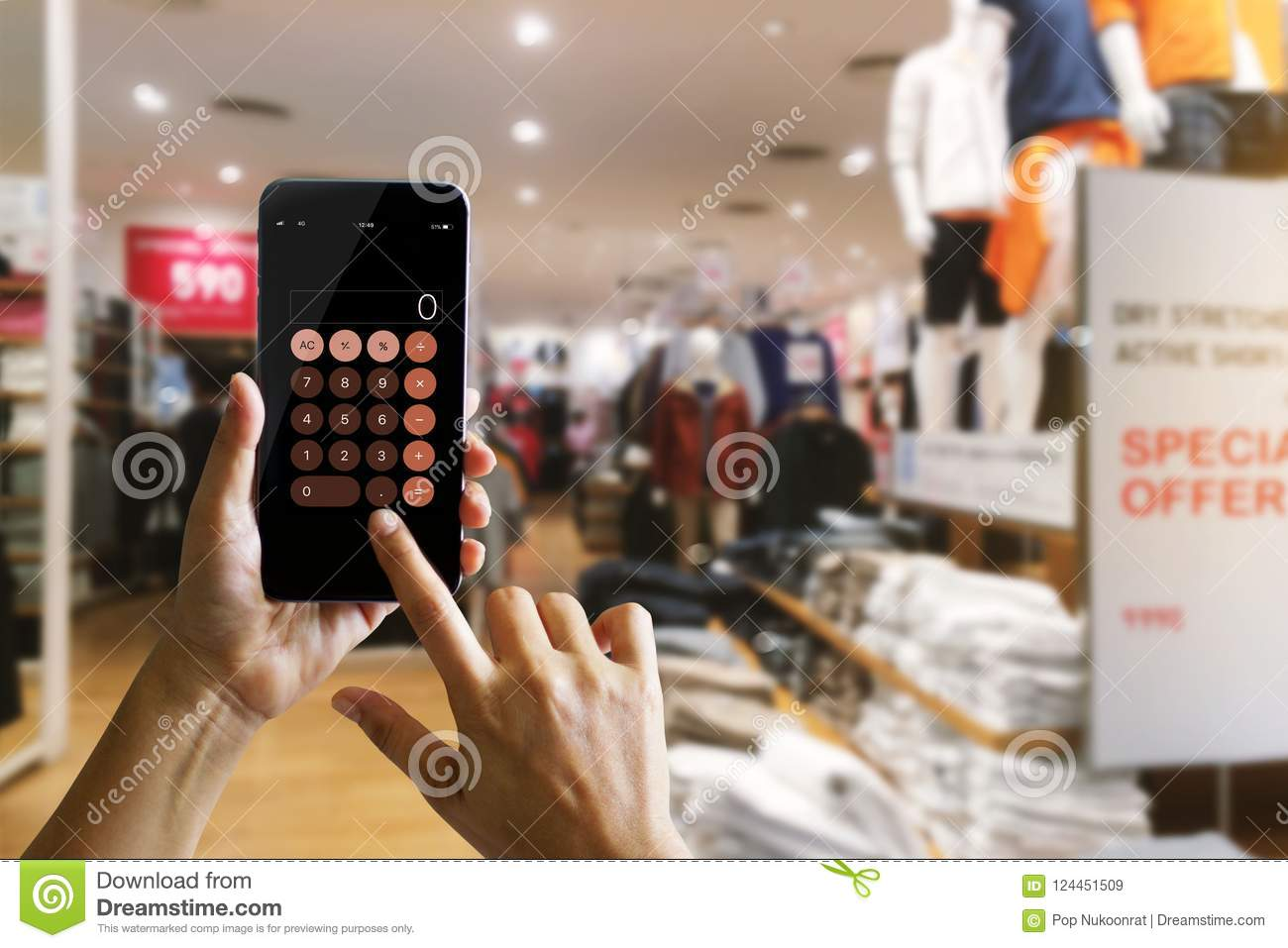 Hands Using Calculator Application On Mobile Smartphone