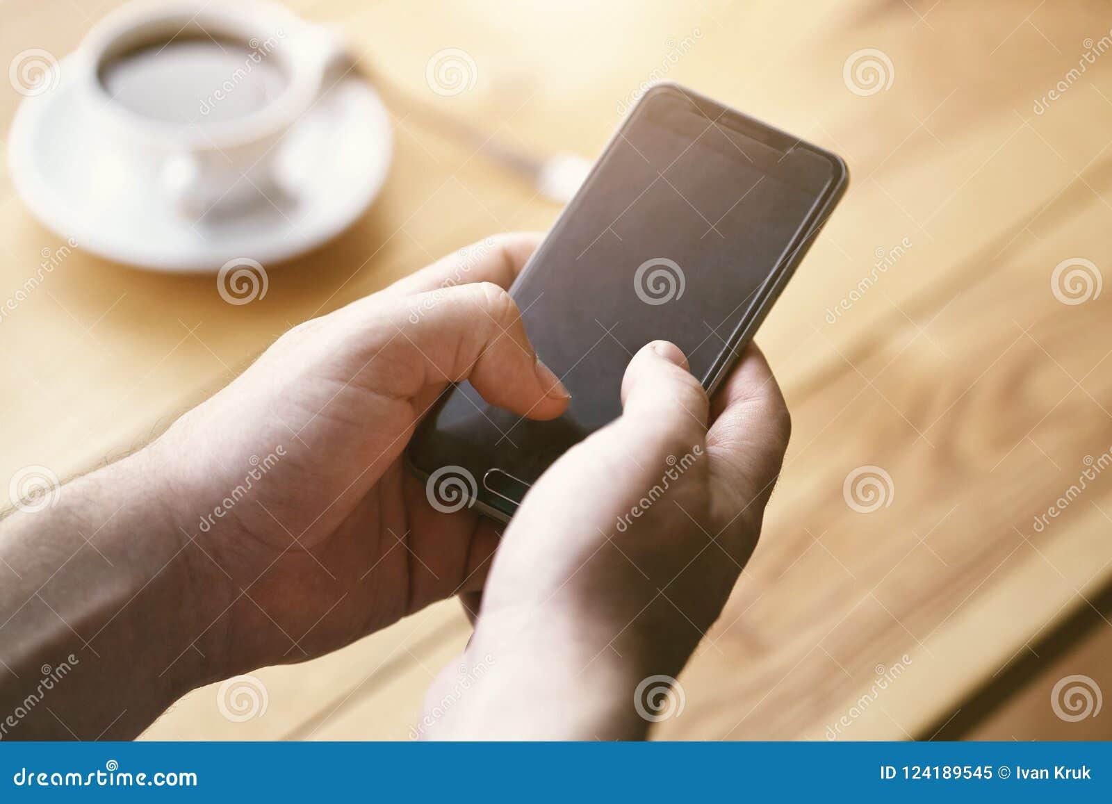 Hands using smart phone touching screen
