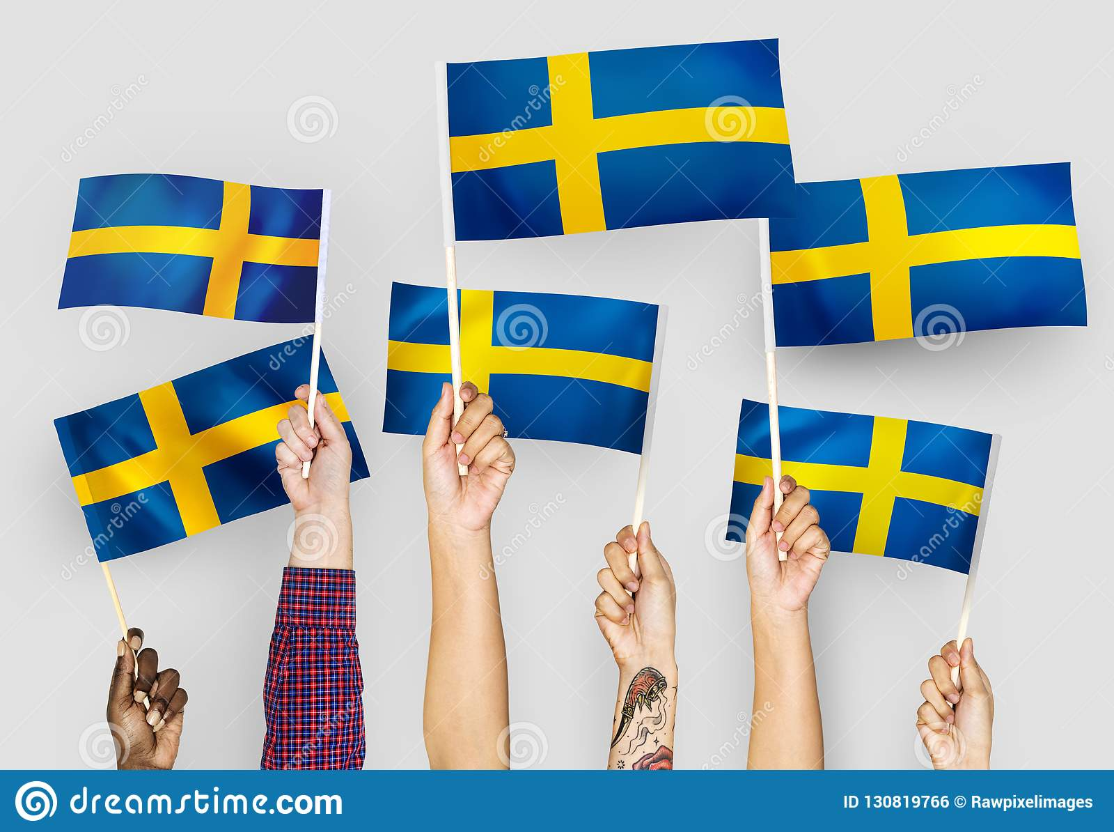 Hands waving the flags of Sweden