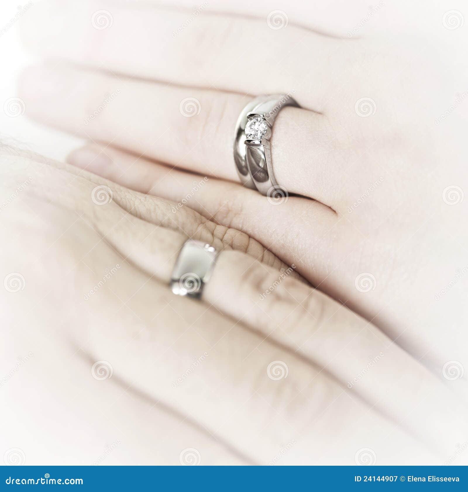 Hands Wearing Wedding Rings Stock Image