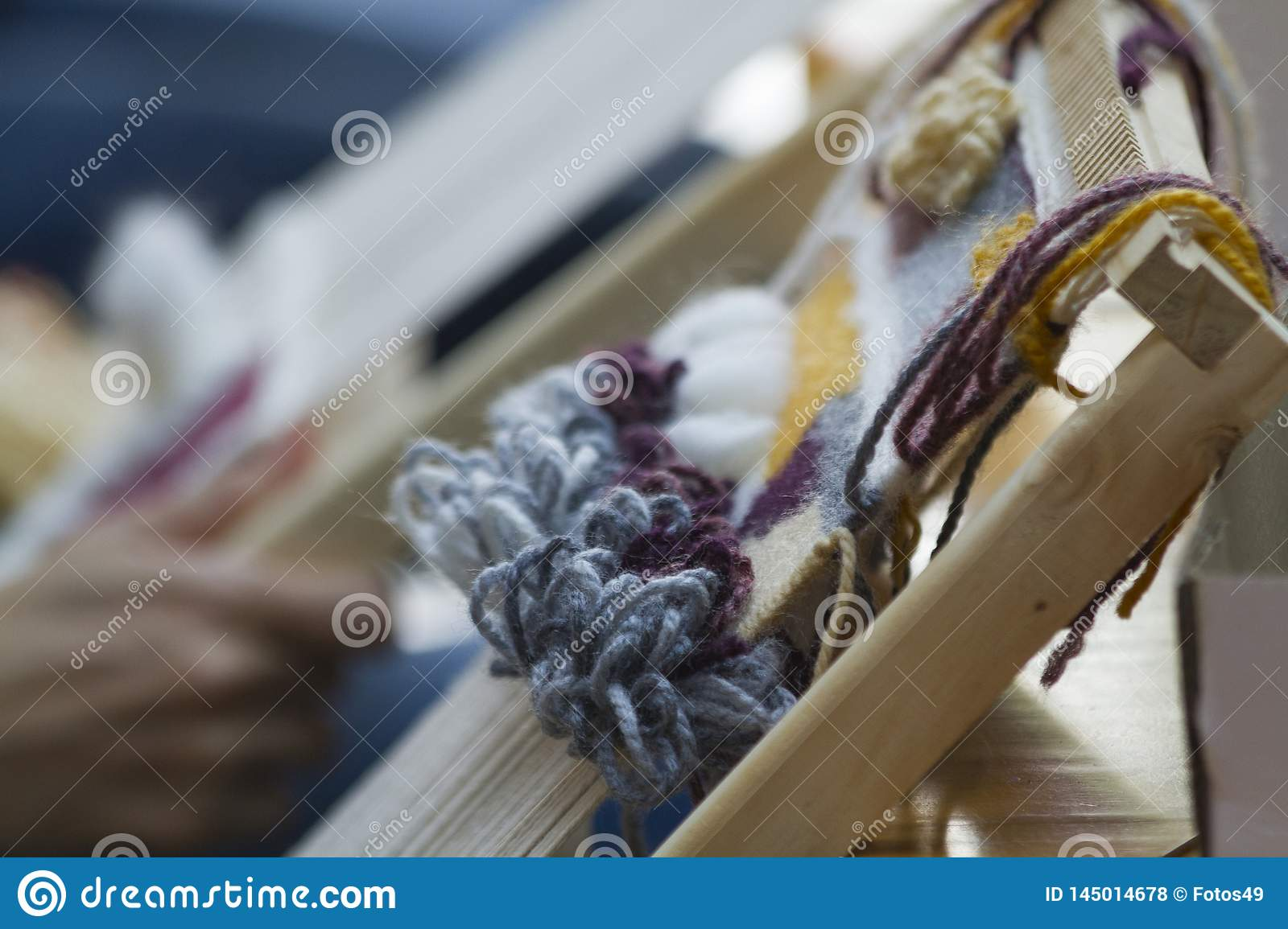 Vertical tapestry with beige yellow and blue  thread