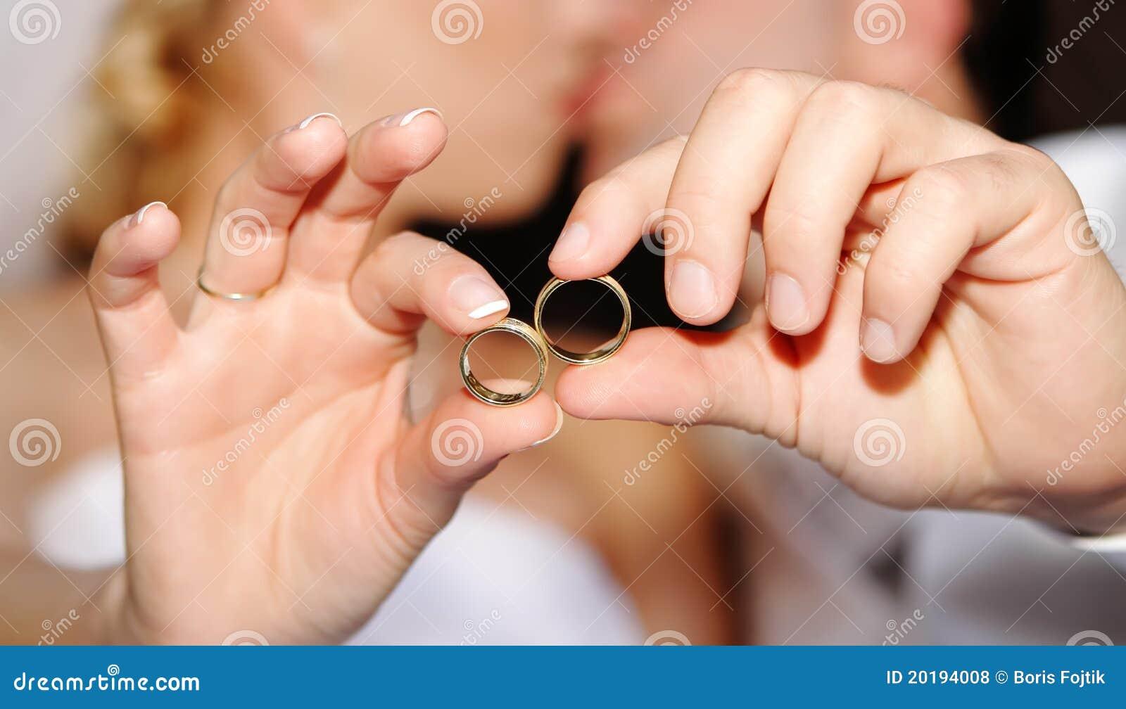 hands wedding rings