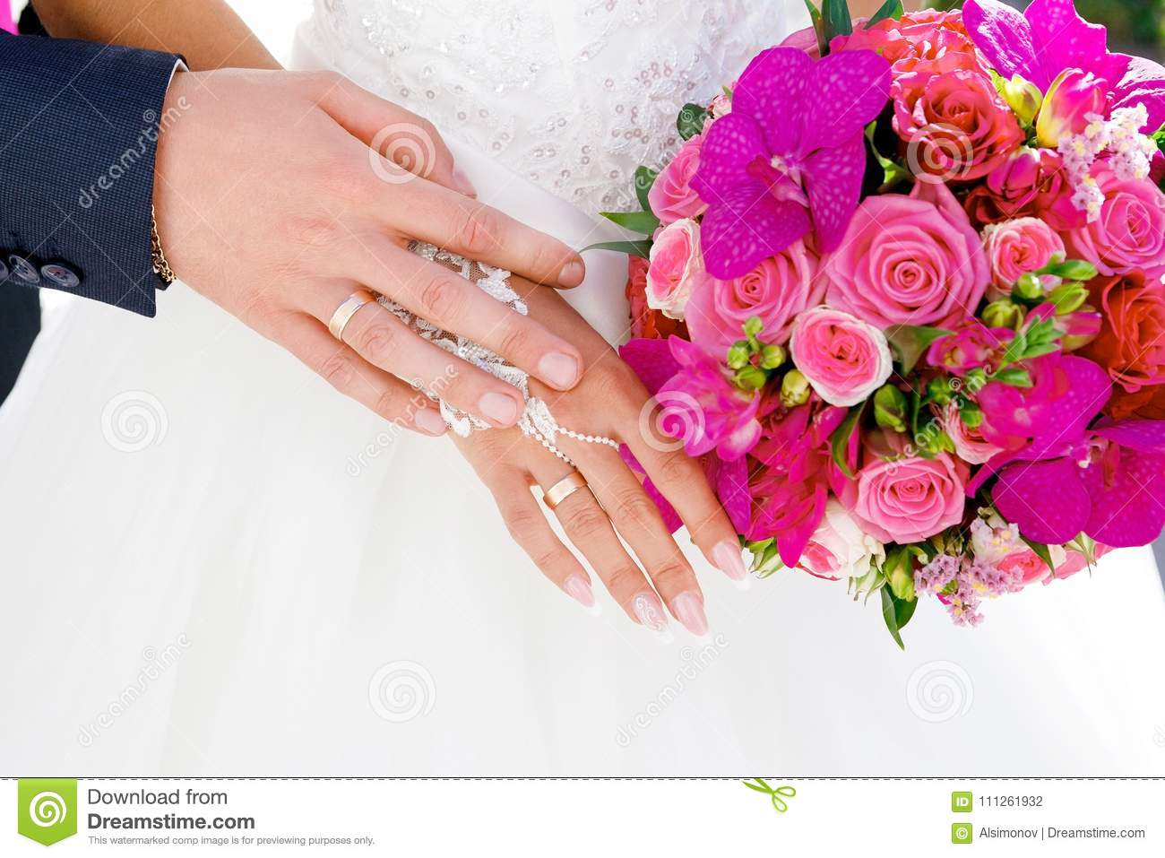 Hands With Wedding Rings On The Background Of White Bridesmaid ...