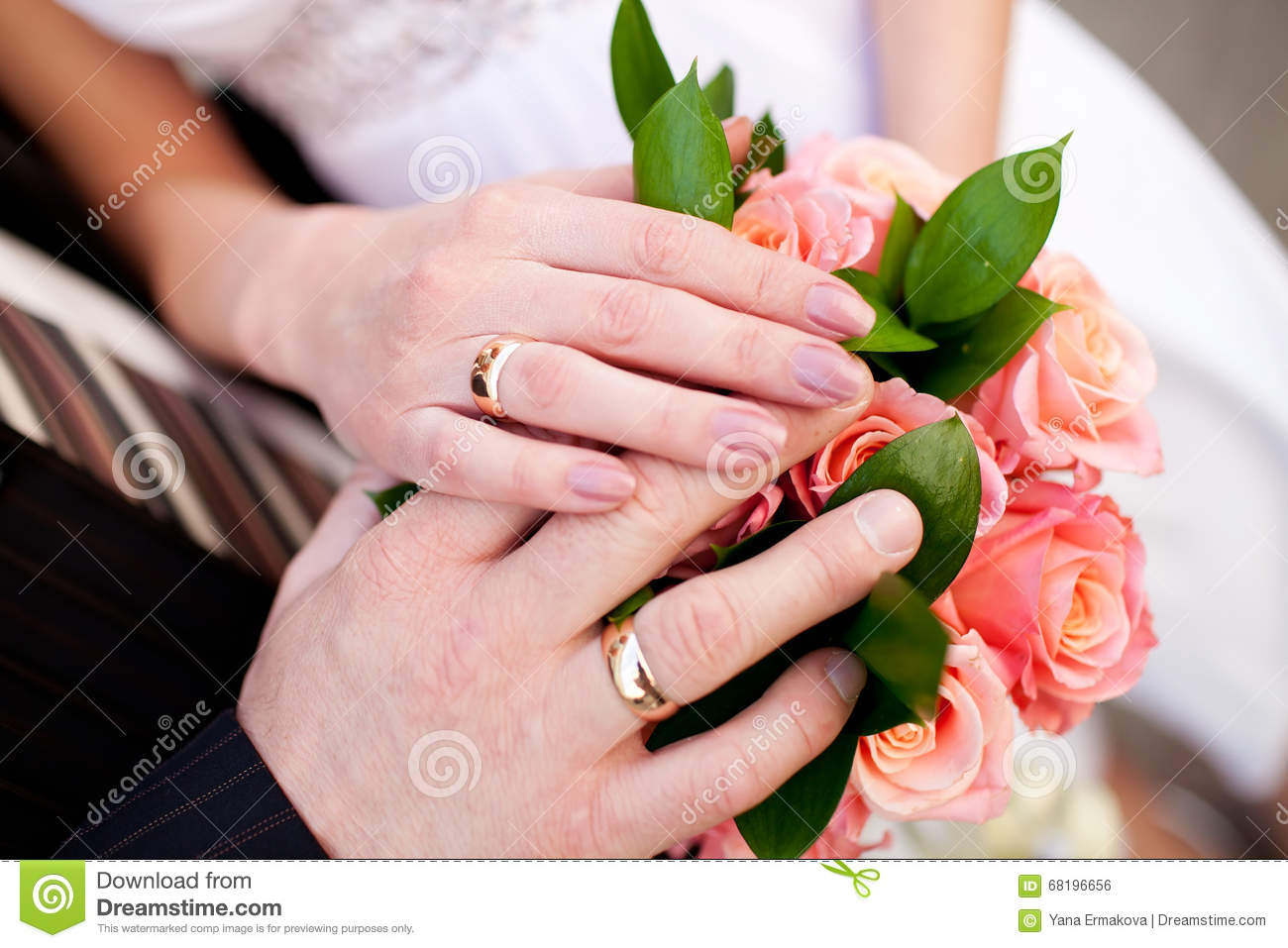 Hands With Wedding Rings On Bridal Bouquet Stock Photo - Image of ...