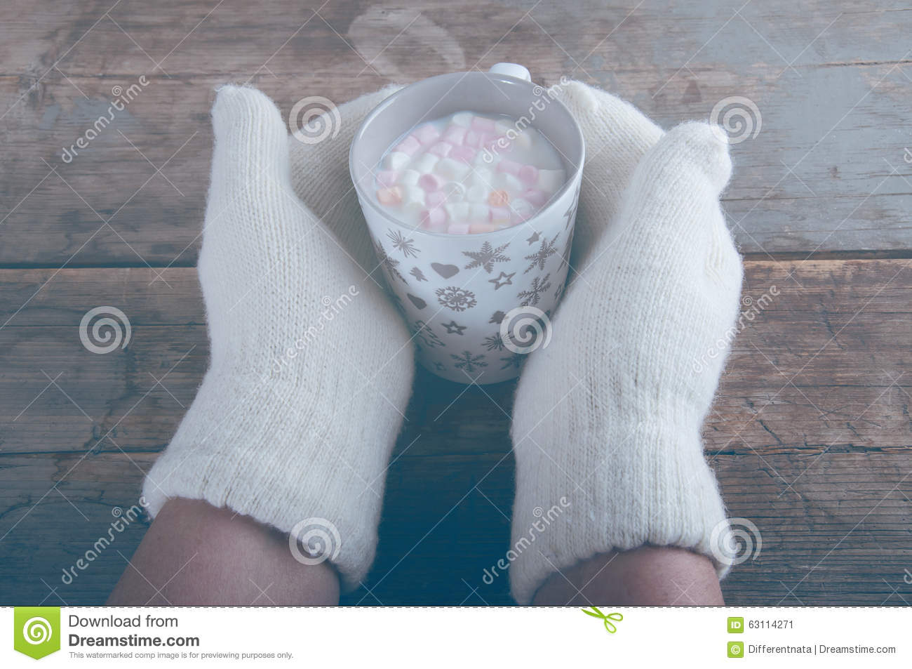 Knitting Pattern For Hand Holding Mittens : Hands In White Mittens Holding Cup Of Hot Milk Stock Photo - Image: 63114271
