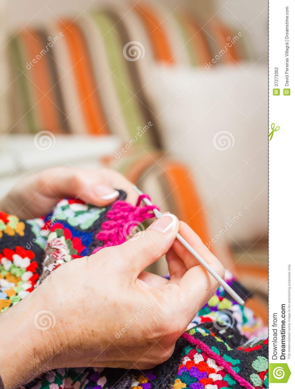Knitting With Hands Only : Hands of woman knitting a vintage wool quilt