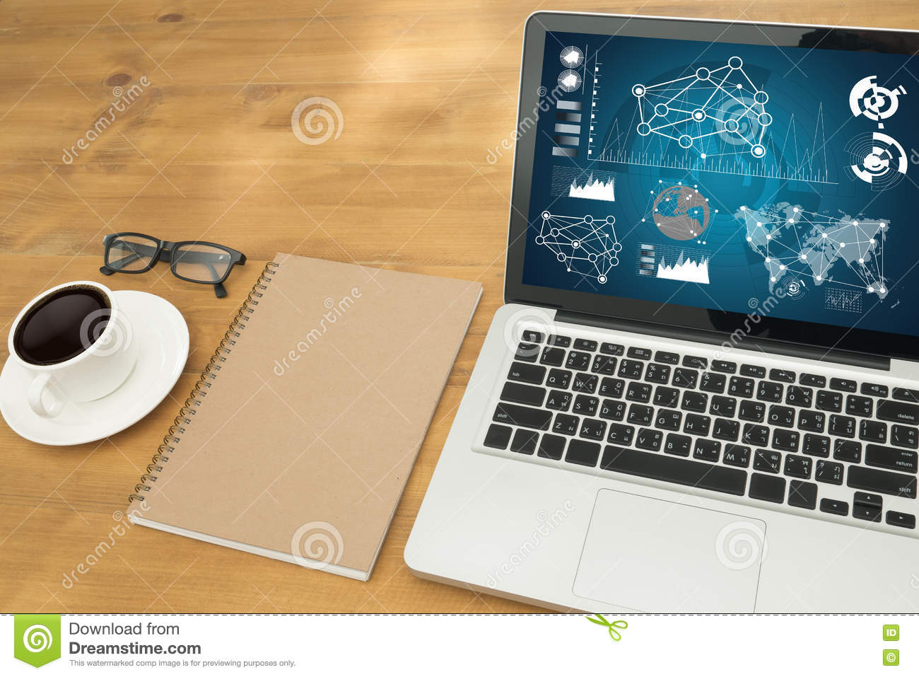 Hands At Work With Financial Reports And A Laptop With Other
