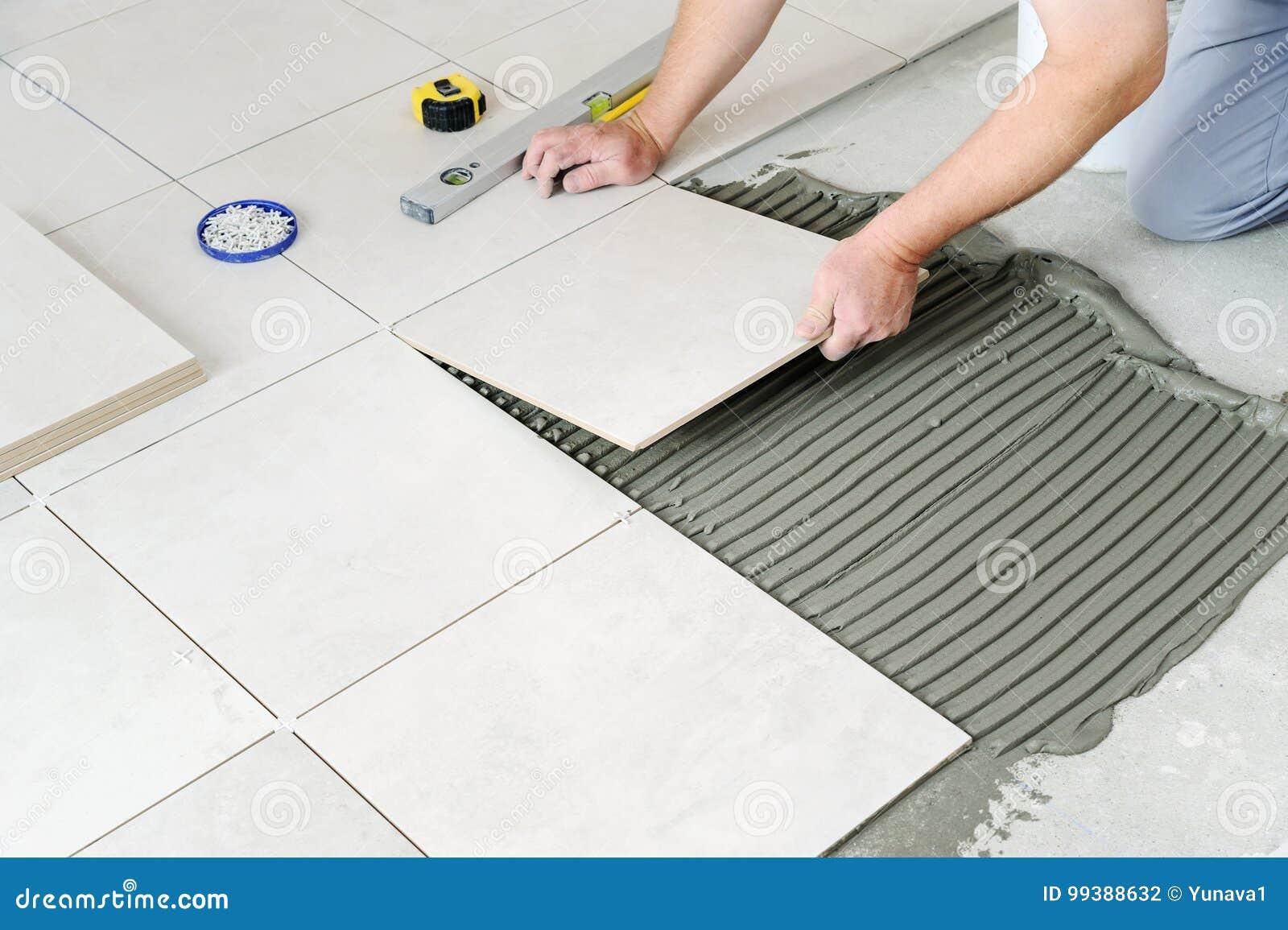 Laying Ceramic Tiles Stock Photo Image Of Hand Adhesive 99388632