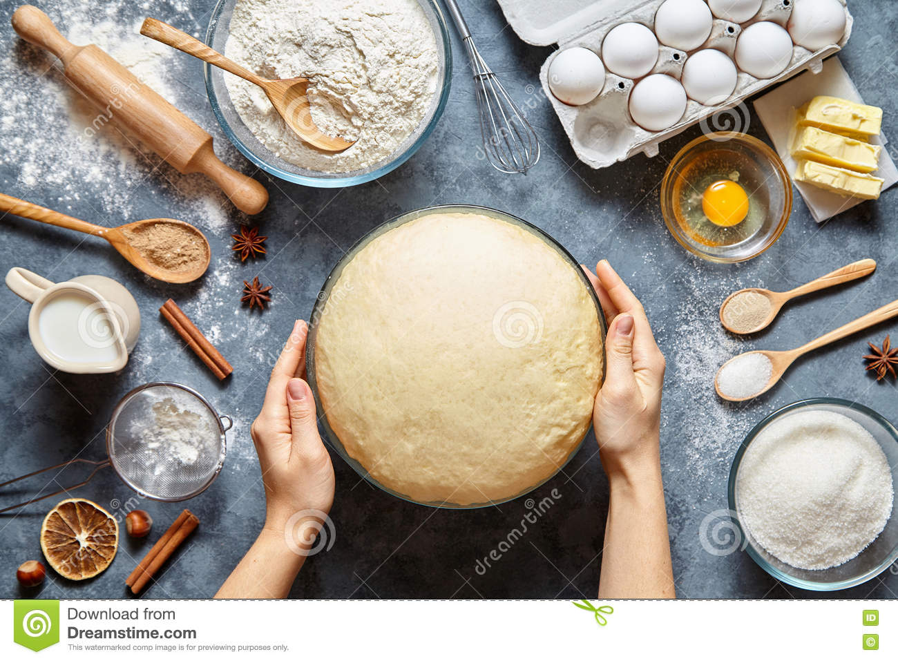 Hands working with dough preparation recipe bread, pizza or pie making ingridients, food flat lay